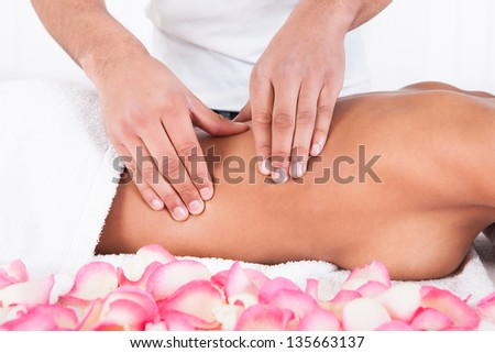 Close-up Of Woman Receiving Massage In Spa - stock photo