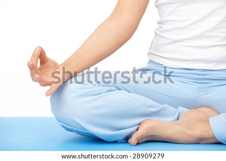 Close-up of woman's hand doing yoga exercise, isolated on white - stock photo