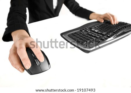 Close up of woman's hands using keyboard and mouse - stock photo