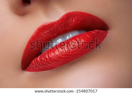 Close-up of Woman's Lips with Bright Fashion Red Lips. Macro burgundy Lipstick Make-up - stock photo
