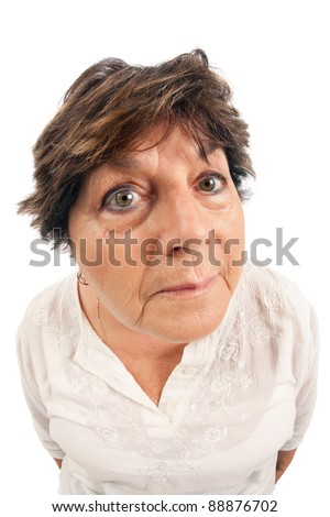 Close-up of woman standing over white background.  Shot with fisheye lens. - stock photo