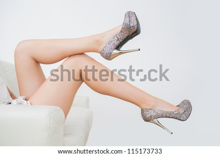 Close-up of woman trying high heels - stock photo
