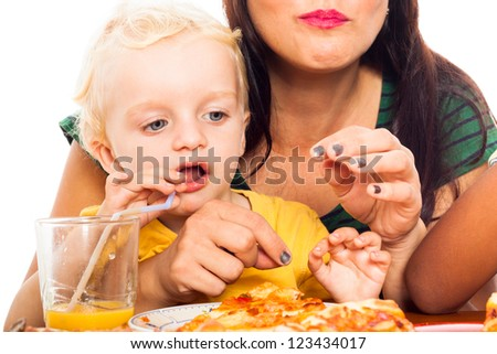 Close up of woman with child boy drinking juice and going to eat pizza, isolated on white background. - stock photo
