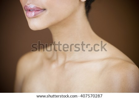 Close-up of womans head showing cheek, ear and neck - stock photo