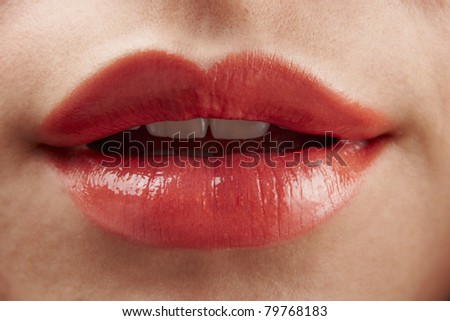 Close-up of womans lips with red glossy lipstick - stock photo