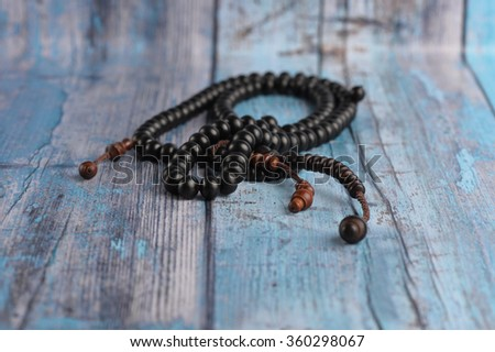 close up of wood tasbih. Wooden rosary. - stock photo