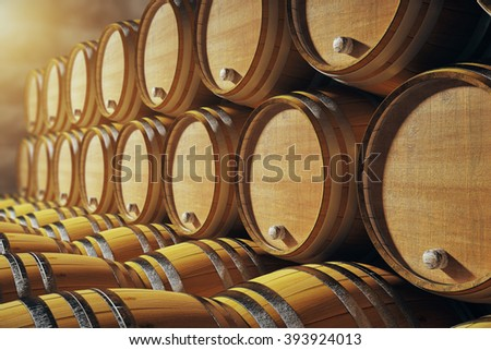 Close up of wooden barrels in winery - stock photo