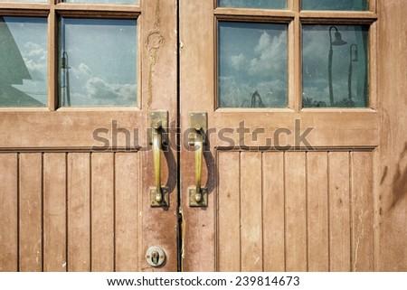 Close up of wooden brown door, selective focus.  - stock photo
