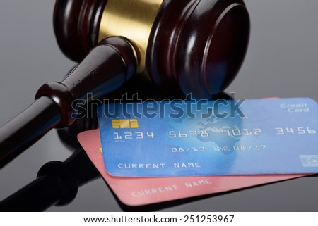 Close-up Of Wooden Brown Gavel With Credit Cards - stock photo