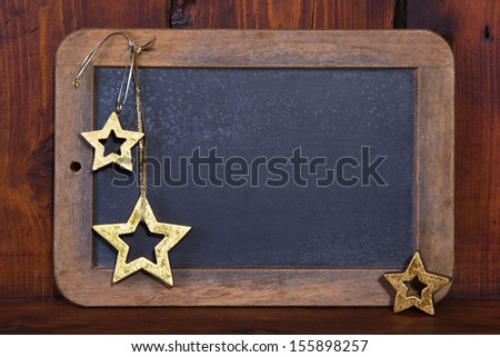 Close up of wooden chalkboard with stars for a christmas greeting card - stock photo