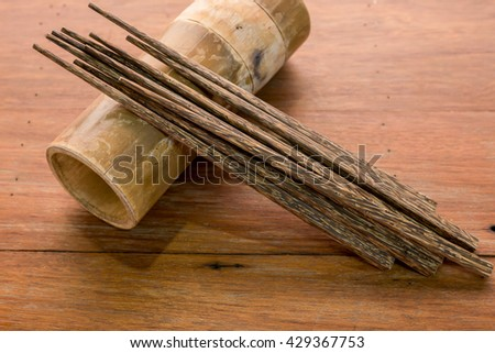 close up of wooden chopsticks on wooden table - stock photo