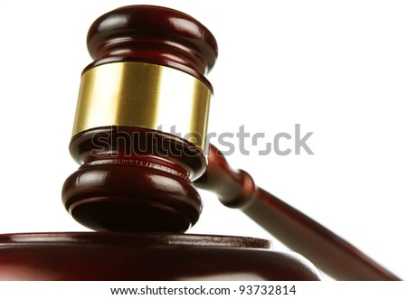 Close up of wooden gavel isolated on white background - stock photo