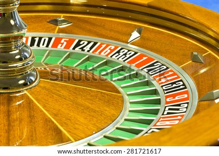 Close up of wooden roulette at the gambling house  - stock photo