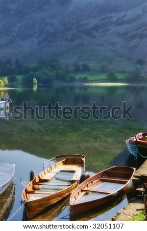 Close up of wooden rowing boats on Lake Ullswater, Lake District National Park, Cumbria, England. - stock photo