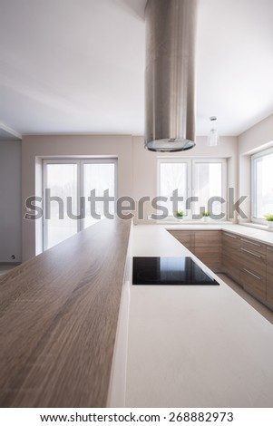 Close-up of wooden worktop in bright kitchen - stock photo