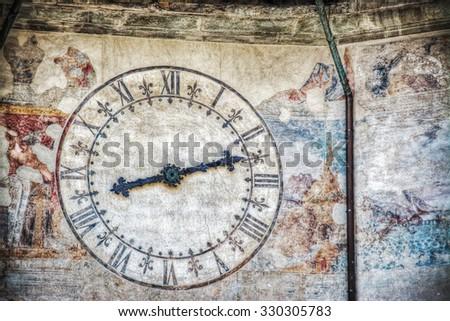 close up of world famous Pisa clock in Piazza dei Cavalieri, Italy - stock photo