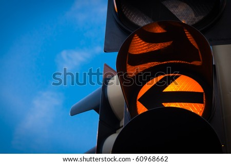 close up of yellow traffic light - stock photo
