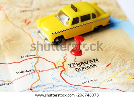 Close up of   Yerevan ,Armenia  map with red pin and a taxi   - Travel concept - stock photo