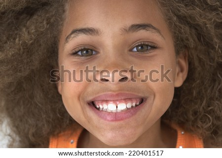 Close up of young African American girl smiling - stock photo