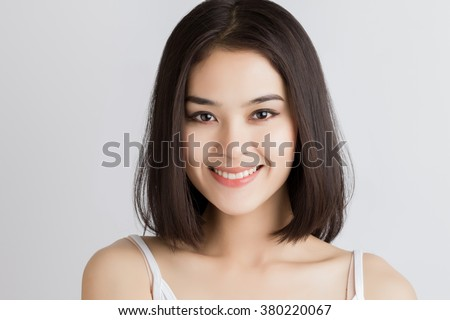 Close up of young Asian beautiful woman with smiley face. - stock photo