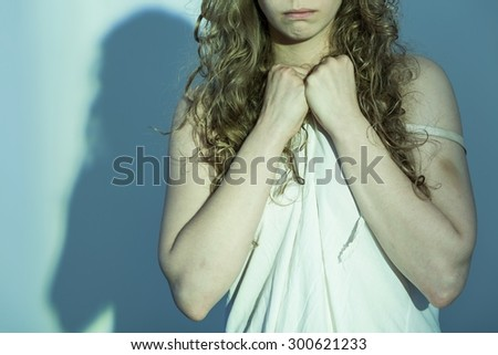 Close-up of young female victim of rape - stock photo