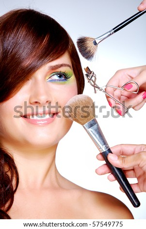 Close-up of young gorgeous female visiting beauty salon - stock photo