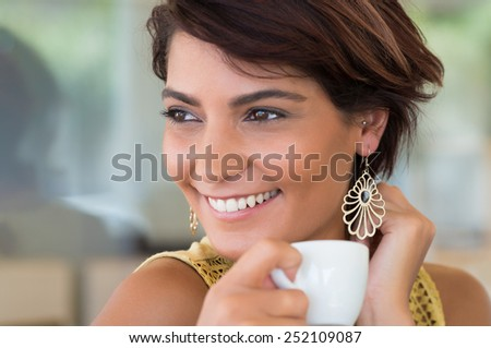 Close Up Of Young Happy Woman Holding Cup Of Coffee At Coffeshop  - stock photo