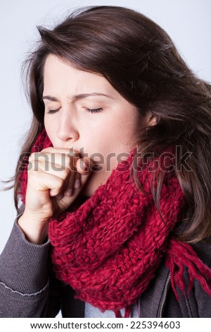 Close-up of young ill woman with cough - stock photo