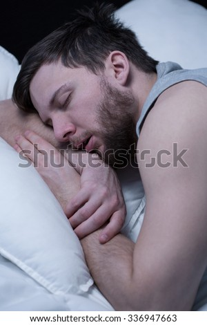 Close-up of young man in deep sleep - stock photo