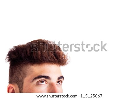 Close-up of young man looking up at copyspace - stock photo