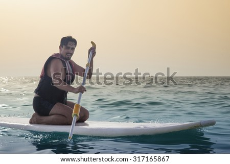Close Up Of Young Man Paddle boarding - stock photo