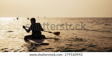 Close Up Of Young Man Paddleboarding - stock photo