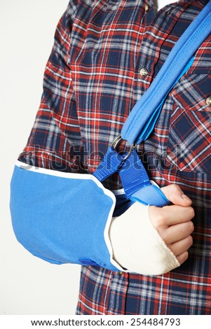Close Up Of Young Man With Arm In Sling - stock photo