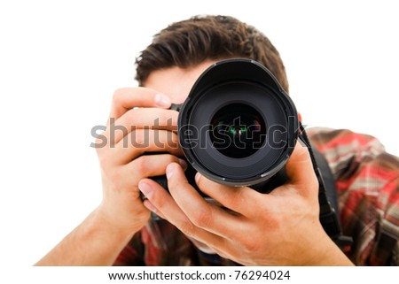 Close-up of Young photographer with camera, isolated on white - stock photo