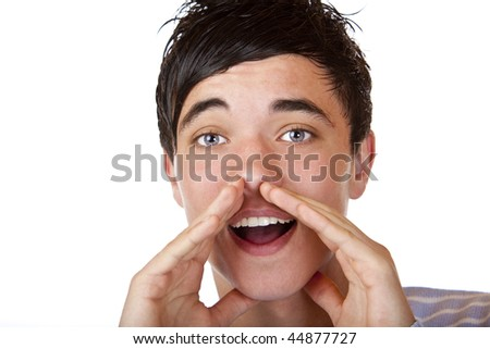 Close-up of young teenager holding hands beside his cheeks and shouts an announcement. Isolated on white. - stock photo