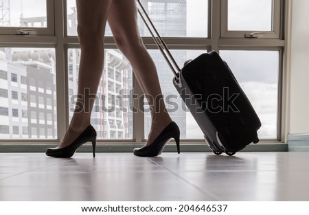 Close up of young woman arriving in a new city. Travel. Moving concept. - stock photo