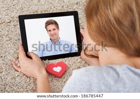 Close-up Of Young Woman Having Video Chat On Digital Tablet - stock photo