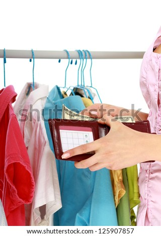 Close-up of young woman paying for her purchases isolated - stock photo