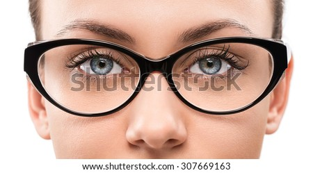Close up of young woman wearing eyeglasses isolated on white background - stock photo