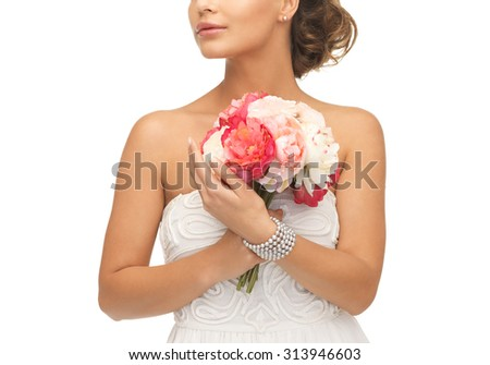 close up of young woman with bouquet of flowers. - stock photo