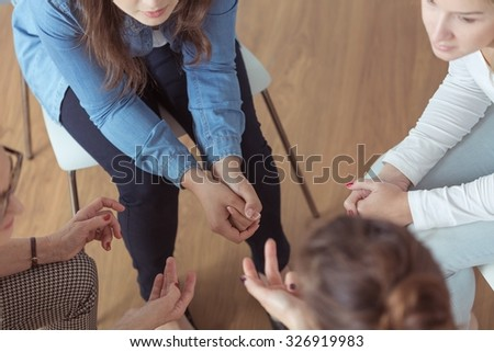 Close-up of young women brainstorming during meeting - stock photo