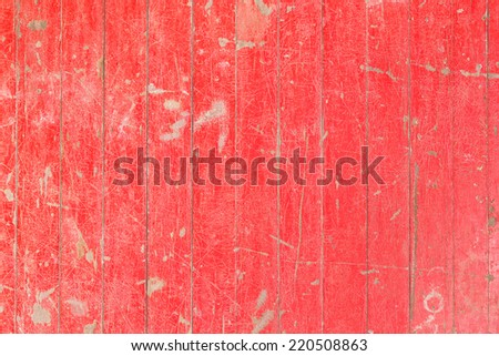Close up old and weathered red color wooden wall texture - stock photo