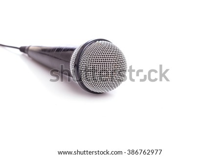 Close up old microphone isolated on white background - stock photo