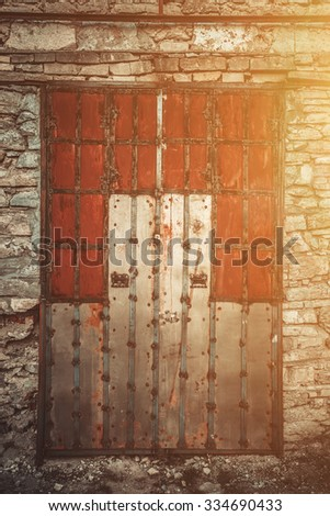 close up Old Wooden door with ornaments in ancient fortress - stock photo