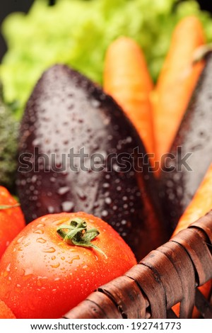Close-up on a basket full of fresh vegetables  - stock photo