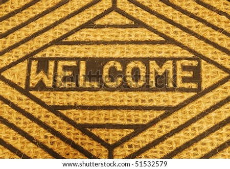 close-up on a beautiful welcome home door mat - stock photo