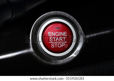 close up on a car start button - stock photo