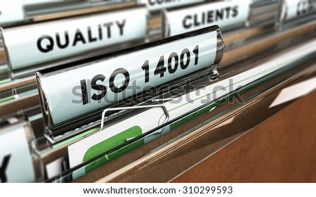 Close up on a file tab with the word ISO 14001, focus on the main text and blur effect. Concept image for illustration of Quality Standards - stock photo