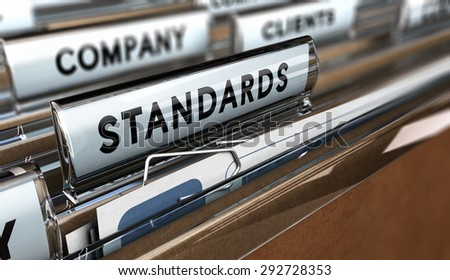 Close up on a file tab with the word standards, focus on the main word and blur effect. Concept image for illustration of quality standard - stock photo