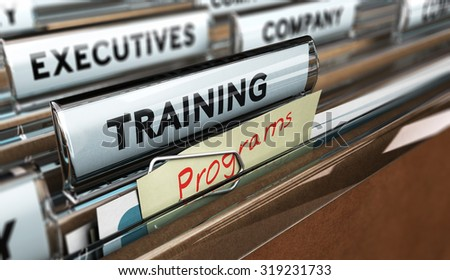 Close up on a file tab with the word training, focus on a yellow, note where it is handwritten program, blur effect. Concept image for illustration of employee, training - stock photo